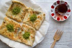 Free Turkish Dessert Katmer With Pistachio Powder And Tea Royalty Free Stock Photos - 77929468