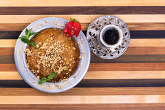 Turkish Dessert Kunefe on Multicolor Wooden Cutting Board Royalty Free Stock Photography