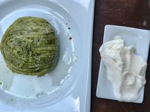 Turkish Dessert Pistachio Roll with Ice Cream served at Restaurant / Fistikli Dolama or Sarma Baklava / Baklawa. Traditional Food Stock Images