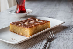 Free Turkish Dessert Sambali , Sambaba Or Damascus With Tea. Royalty Free Stock Images - 81045399
