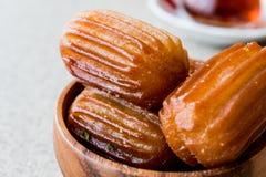 Turkish Dessert Tulumba tatlisi with tea. Royalty Free Stock Photo
