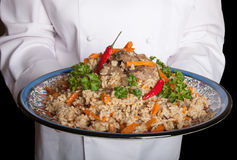 Turkish dish with pilaf in the hands of the cook Stock Photography