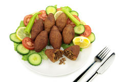 Turkish dish, stuffed meatballs with bulgur - ( icli kofte ) Royalty Free Stock Photography