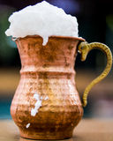 Turkish Drink Ayran or Buttermilk with foam in copper cup. Royalty Free Stock Photos