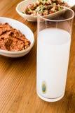 Turkish Drink Raki with acili ezme and gavurdagi salad with walnut Stock Photo