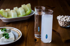 Turkish Drink Raki with melon and white chickpeas. Royalty Free Stock Images