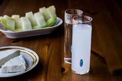 Turkish Drink Raki with melon and white chickpeas. Stock Image