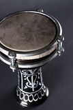 Turkish drum on black closeup. Black small turkish bass drum on black background Stock Photography