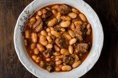 Turkish Etli Kuru Fasulye / Baked Beans with meat. closeup view Stock Images