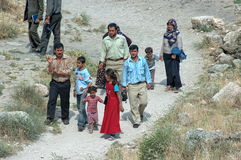 Turkish Family Walking On Road. Picture taken in Harran, Turkey, a district of Sanliurfa Province close to the Syrian border. The Turkish government currently stock images