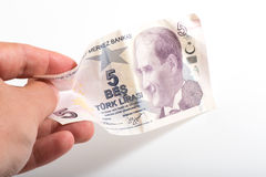 Turkish five  money with hand and white background Royalty Free Stock Photo