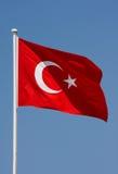 Turkish Flag. Waving over blue sky stock image