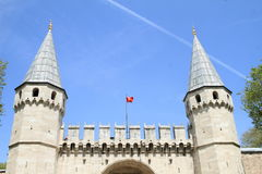 Turkish flag above `Turkish Tours by Local Guides`. Defend wall and towers fortification with blue sky behind in Istanbul, Turkey Royalty Free Stock Photos