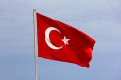 Turkish flag against of the blue sky. Royalty Free Stock Image