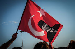 Turkish Flag With Ataturk On Gassed Man Festival. In Kadikoy - Istanbul / Turkey. A protesting festival against excessive use of police force. Photo taken at Stock Photo