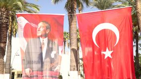 Turkish flag with Ataturk waving in Bodrum - TURKEY. Turkish flag waving in Bodrum stock video footage