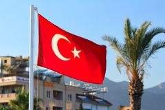 Turkish flag on the background of the hotel. Royalty Free Stock Photos