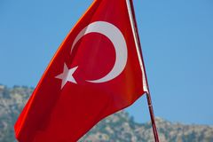 Turkish flag on a background of mountains stock photography