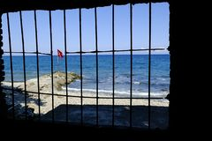Turkish flag behind bars royalty free stock photography