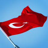 Turkish flag on the blue sky. Aged photo. Flag of Turkey. Stock Photography