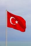 Turkish flag on blue sky background. Stock Photo