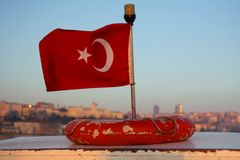 Turkish flag on a boad, Istanbul in the background Royalty Free Stock Photos