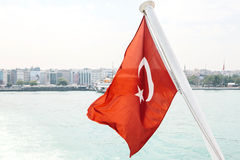 Turkish flag on the border. In the background is Istanbul. The symbol of Turkey. Turkish flag on the border. In the background is Istanbul. The symbol royalty free stock photography