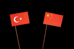 Turkish flag with Chinese flag on black stock photos
