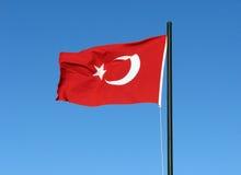 Turkish flag. On the flagpole on blue sky background Royalty Free Stock Photography