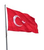 Turkish flag on flagpole waving in wind. Isolated on white background royalty free stock image