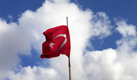 Turkish flag on flagpole waving in wind Stock Images