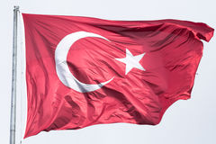Turkish flag floating in the air. Picture of the official turkish flag hoisted in a windy environment Stock Image