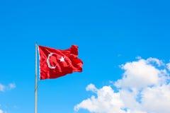 Turkish flag fluttering. On blue sky background stock photo