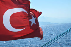 Turkish flag fluttering on a boat Stock Images