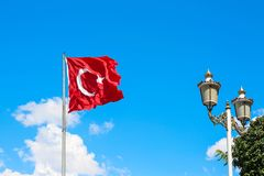 Turkish flag fluttering on sky background. Turkish flag fluttering on blue sky background royalty free stock photos