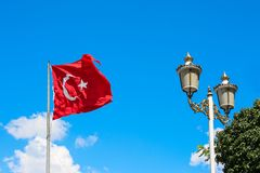 Turkish flag fluttering. On blue sky background royalty free stock photography