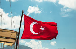 The Turkish flag flutters Stock Photos