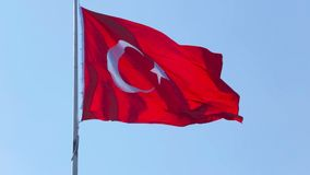 Turkish flag flutters in wind in sunny day, tourism, muslim religion and culture. Stock footage stock video footage