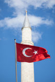 Turkish flag in front of minaret Stock Photography