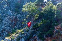 Turkish flag on a rock stock image