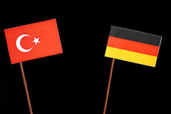 Turkish flag with German flag on black stock photos
