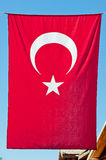 Turkish flag hanging vertically. Royalty Free Stock Photography