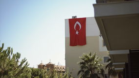 Turkish flag hanging on the wall of the house. National holiday and traditions of Turkey stock video