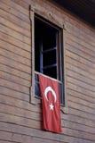 Turkish flag hanging on window royalty free stock images