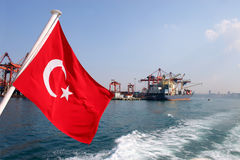 Turkish flag, Istanbul - Turkey. Turkish flag with a freighter on Istanbul harbor royalty free stock photography