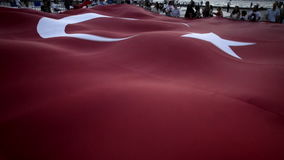 Turkish flag. Izmir, Turkey - August 30, 2016: Alsancak gundogdu square. 30 August is victory bairam in Turkey and people are celebrating. There is a Huge stock video footage