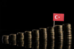 Turkish flag with lot of coins on black stock images