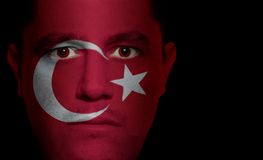 Turkish Flag - Male Face. Turkish flag painted/projected onto a man's face Royalty Free Stock Image