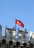 Turkish flag on medieval castle. Turkish flag on Topkapi Palace in Istanbul, Turkey Royalty Free Stock Images