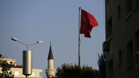 Turkish flag and mosque. Turkish flag is waving with wind stock video